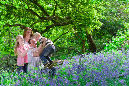 bluebell: Family playing in field of bluebell flowers