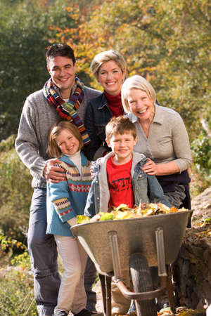 three generation: Portrait of three generation family standing near wheelbarrow