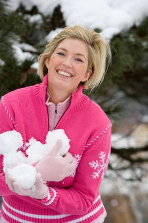 palle di neve: metà donna adulta azienda palle di neve felice