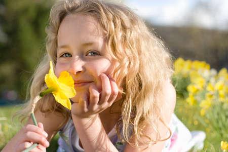 smelling: Girl smelling flower LANG_EVOIMAGES