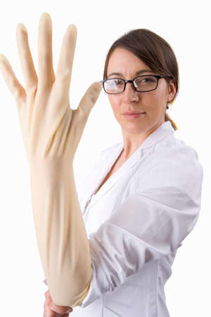 surgical glove: Doctor putting surgical glove on with attitude