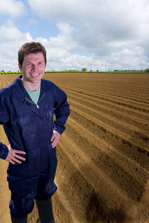 the ploughed field: Farmer standing with hands on hips in ploughed field