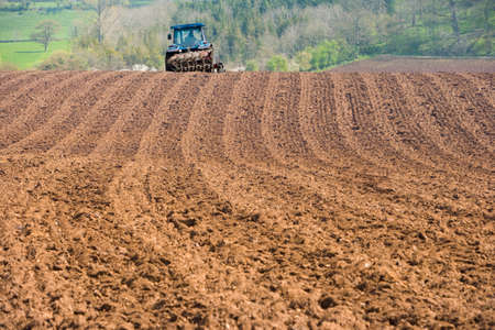 ploughing field: Tractor ploughing field LANG_EVOIMAGES