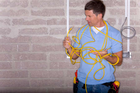 entangled: Man entangled in electrical cable