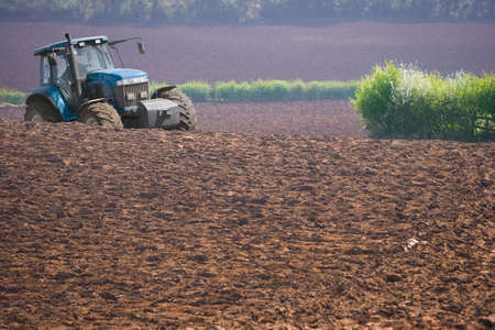 ploughing: Tractor ploughing field LANG_EVOIMAGES