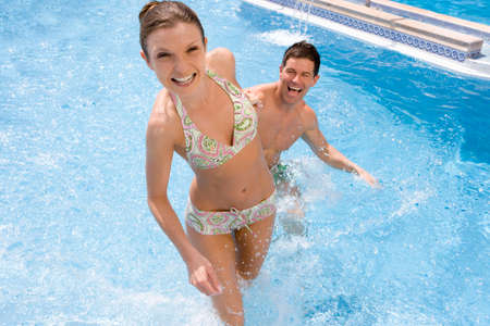 waist deep: Smiling couple in swimming pool