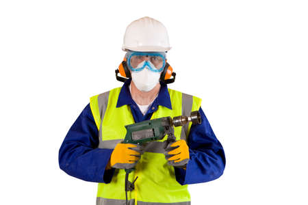 Construction worker with drill in protective clothing