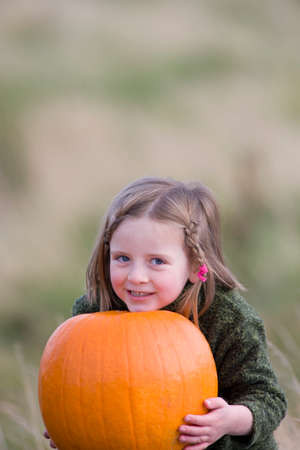 large pumpkin: Girl with large pumpkin