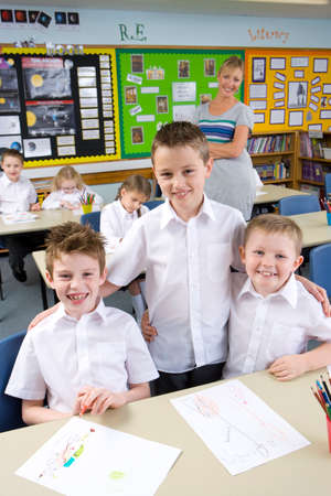 three friends: School boy friends smiling in classroom