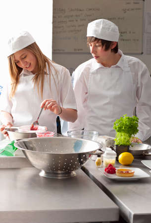 working together: Trainee chefs working together in commercial kitchen