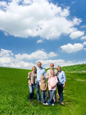 farm field: Multi-generational family standing in field LANG_EVOIMAGES