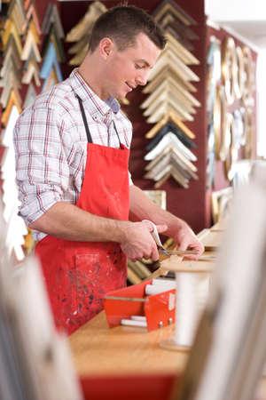 framer: Craftsman working on frame in frame shop
