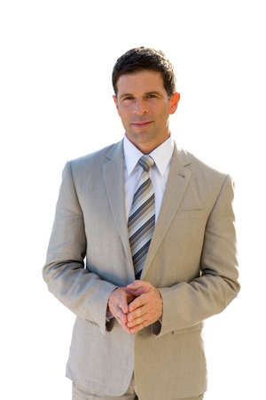 clasped: Smiling businessman in suit with hands clasped