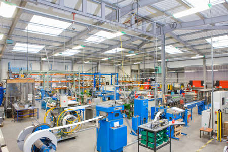 View of machinery in factory which manufactures aluminium light fittings LANG_EVOIMAGES