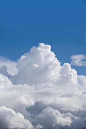 puffy: Puffy clouds in sunny, blue sky LANG_EVOIMAGES