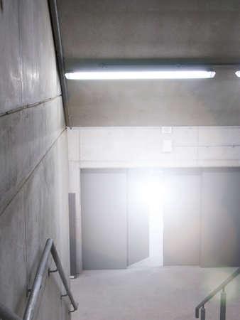stairwell: Cement stairwell with sun shining in open doorway