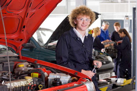 vocational: Student repairing car in automotive vocational school LANG_EVOIMAGES