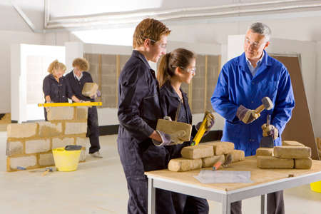 vocational: Teacher teaching students bricklaying in vocational school