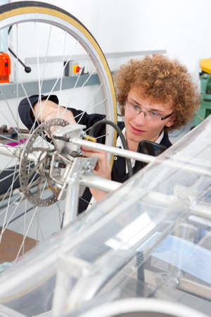 vocational high school: Student constructing electric vehicle prototype in vocational school