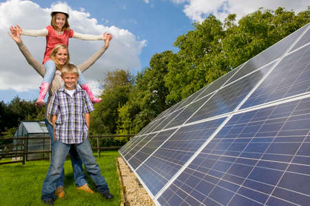 one family: Happy family standing together near large solar panels