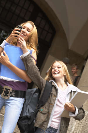 snatch: A young girl trying to snatch a mobile phone from another girl LANG_EVOIMAGES