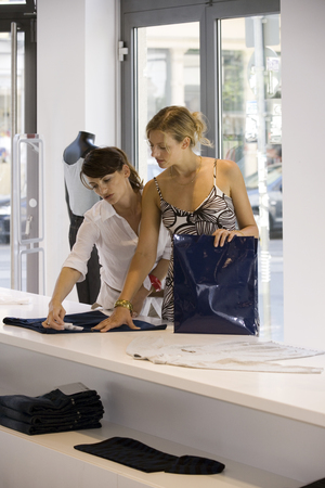 two persons only: Women looking at clothes in a boutique LANG_EVOIMAGES