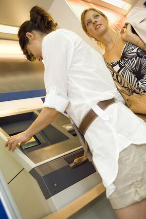 low blouse: Women at an ATM machine