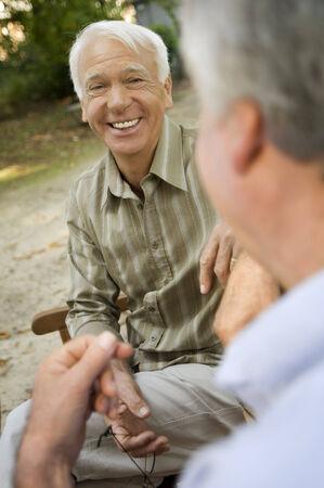 Two elderly men having a laugh