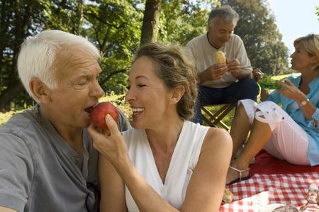 Elderly couples enjoying a picnic
