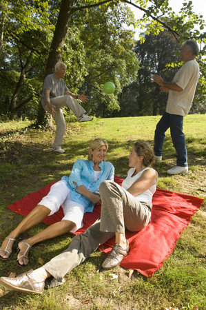 Two elderly couples in the nature Stock Photo