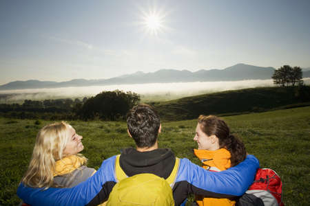 three persons only: Three friends enjoying the evening view
