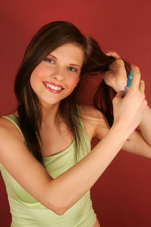 hairspray: A young woman applying hairspray