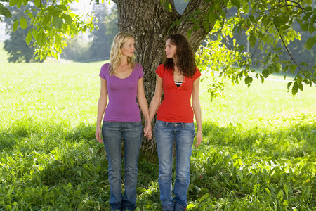 nude lesbian: Two friends holding hands,looking at each other