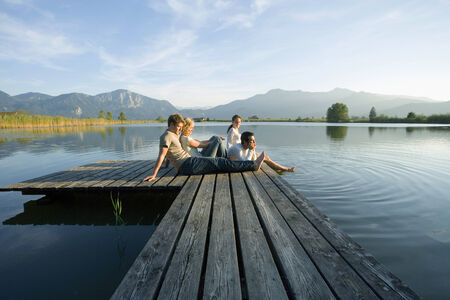 peacefulness: Two couples relaxing on a pier