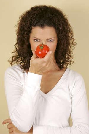 A woman holding a tomato Stock Photo