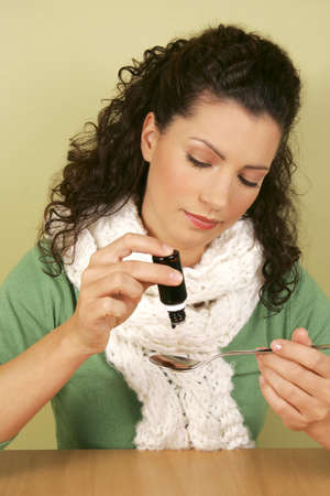 A woman taking medicine Stock Photo