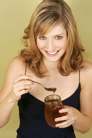 spaghetti strap: A woman having honey