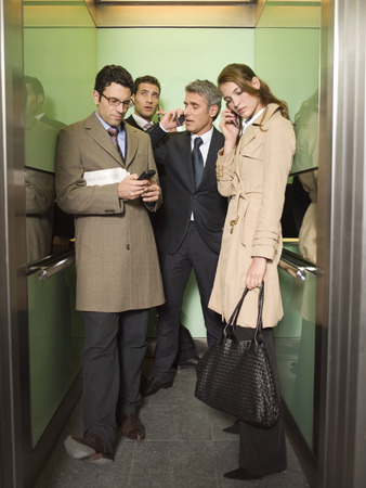 Four business people talking on the phone Imagens