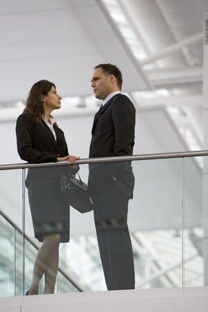 low blouse: Two business people talking
