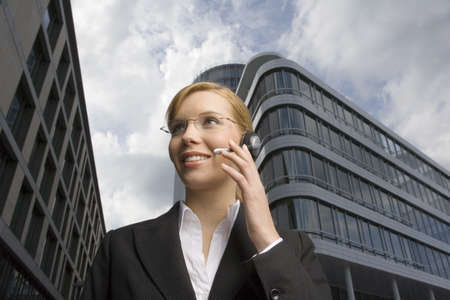 low blouse: A businesswoman wearing a headset