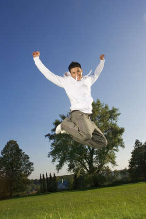 spiked hair: A teenage boy jumping in the air