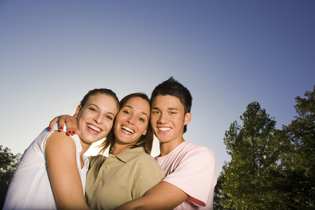 girl short hair: Three teenage friends hugging LANG_EVOIMAGES