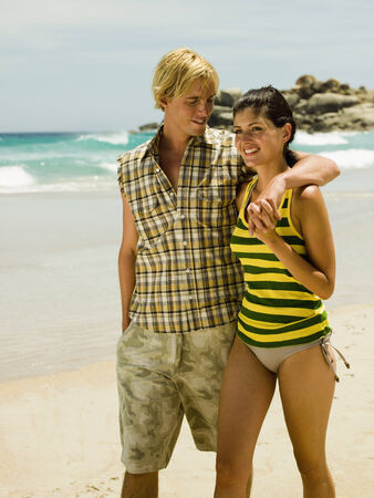 two piece swimsuits: Couple on the beach