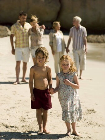 three generation: Three generation family at the beach LANG_EVOIMAGES