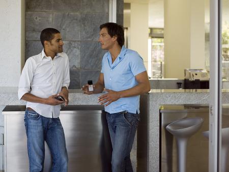 two men talking: Two men talking.