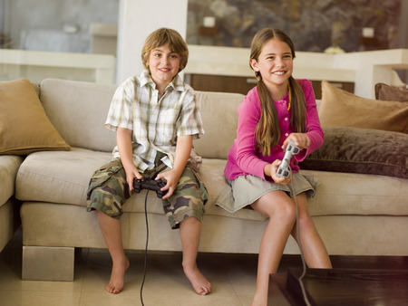 family: Children playing playstation