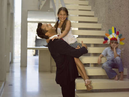 favoring: Father carrying daughter,Son sitting on the stairs