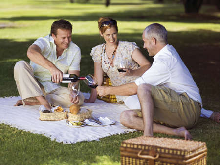 three persons only: People having wine at a park