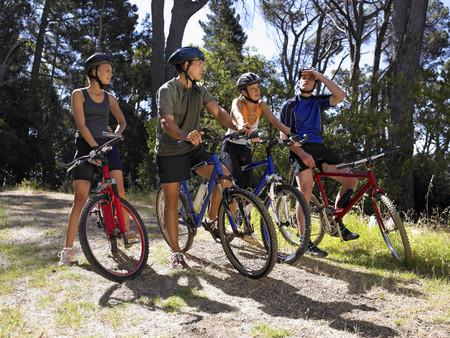 mountain biking: Two young couples mountain biking