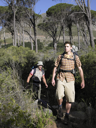 young men: Two young men hiking in the forest